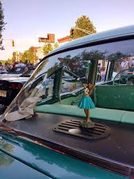 hula in the window of a classic car editorial image