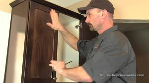 Hanging Cabinet Doors by How To Install Cabinet Doors U0026 Drawer Fronts Youtube