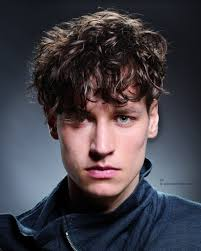 curly hairstyle with undercut sides for men