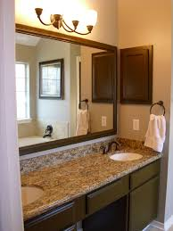 light bathroom ideas black stained wooden frame glass window brown