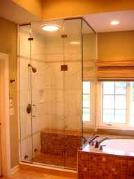 small corner shower stall with floor to ceiling sliding glass door