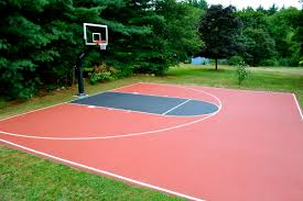very nice treed in backyard half court a surfaced striped and