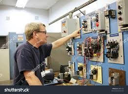 electrical teacher working on industrial motor stock photo 3983152
