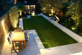 small family garden ideas the lighting makes this garden look cosy outdoor lighting