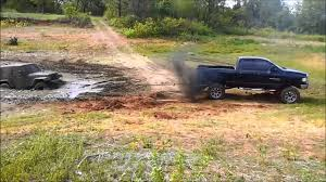 muddy monster truck videos one insane gmc monster truck flips in the mud