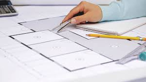 writing concept papers business architecture building construction and people concept business architecture building construction and people concept architect woman measuring blueprint with compass and writing dimensions to notebook