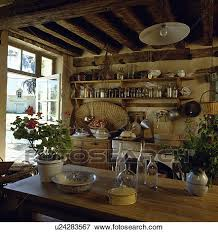 Rustic Cottage Kitchens - picture of rustic cottage kitchen with wooden table and shelving