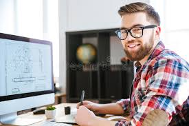 blue print designer happy designer drawing blueprint on computer using pen tablet stock
