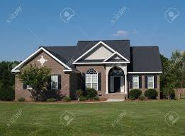 one story house one story new brown brick residential home stock photo picture