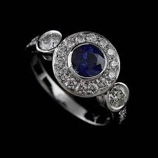 white gold art deco three stone diamond sapphire halo engagement