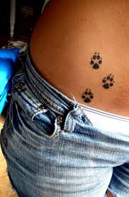 hip tattoo with the paws of my lil pup that died awhhh my heart