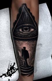 illuminati eye tattoo on arm by luci