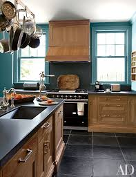 kitchen cabinet colors for black countertops 25 black countertops to inspire your kitchen renovation
