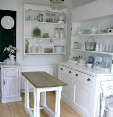 free standing kitchen cabinets with white color and countertop and