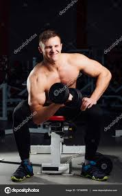 Bench Exercises With Dumbbells Professional Bodybuilder Do Exercises For Biceps Sitting On The