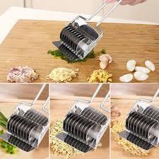cuisine coriandre acier inoxydable nouilles coupe appuyant sur machine échalote oignon