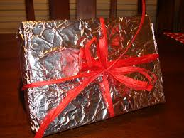 metallic christmas wrapping paper 16 ideas for wrapping presents without wrapping paper the budget
