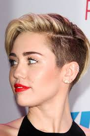 what is the name of miley cryus hair cut miley cyrus straight light brown side part undercut hairstyle