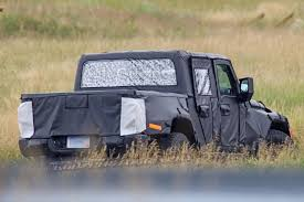 2019 jeep wrangler pickup truck spy photos reveal more about jeep wrangler pickup autoguide com news