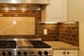 OLYMPIC Kitchens - Brown tile backsplash