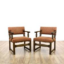 pair of orange spanish revival accent chairs spanish revival