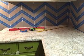 how to paint tile backsplash in kitchen diy herringbone tile backsplash