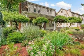 brighton house comes with finished basement and lush yard curbed
