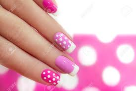 nail design with white dots on the french manicure with pink