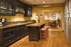 wood floors with dark cabinets white ceramic wall tiles on