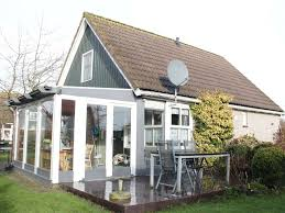holiday house with winter garden in a quiet holiday park with