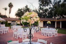 beautiful centerpiece at outdoor wedding arrangement of light