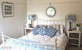 charming beach themed coastal master bedroom with white painted