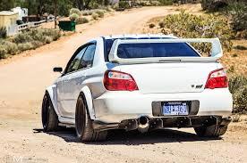 custom subaru impreza 2007 subaru impreza wrx sti rear view dusty road stance