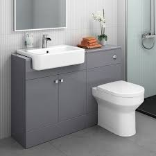 modern bathroom toilet and furniture storage vanity unit sink