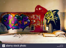 old mattresses on the floor in a room with graffiti walls inside