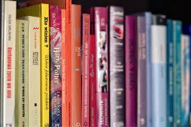 colorful books on shelf free stock photo