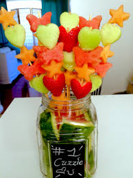 diy edible arrangement in medium sized mason jar with chalk board