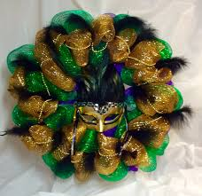 black and gold mardi gras mardi gras wreath gold warrior goddess mask black feathers