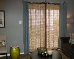 curtains room with windows and balcony door balcony door