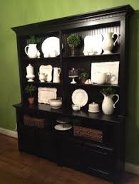 dark charcoal or black stain for the dining room china hutch would
