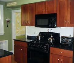 kitchen backsplash cherry cabinets black counter