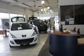 peugeot car dealership revamp for perrys peugeot dealership car news reviews u0026 buyers