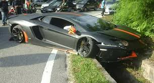 black on black lamborghini aventador matte black and orange lamborghini aventador crashes in malaysia