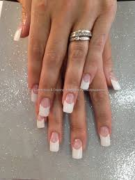 classic french acrylic nails with swaroski crystals on ring