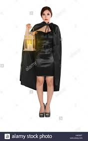 female witch costume young asian woman in a witch costume with cloak holding lantern