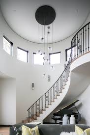 bold modern chandeliers for two story foyers