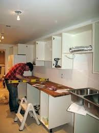putting up kitchen cabinets kitchen cabinet installation cost ibbc club