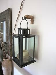 Western Curtain Rod Holders by Repurposing Old Curtain Rod Bracket To Hold Lanterns On Wall Diy