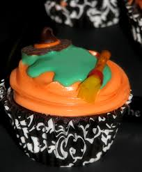 halloween graveyard cupcakes with gravestones saying