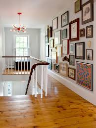 picture hanging ideas how to hang pictures in your home s hallway